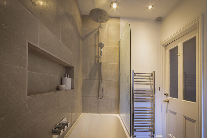 Modern bathroom with waterfall shower