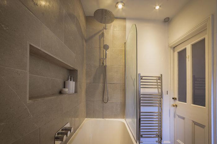 Modern bathroom with waterfall shower